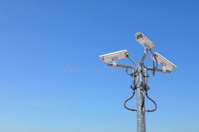 Trois caméras de sécurité extérieures image libre de droits