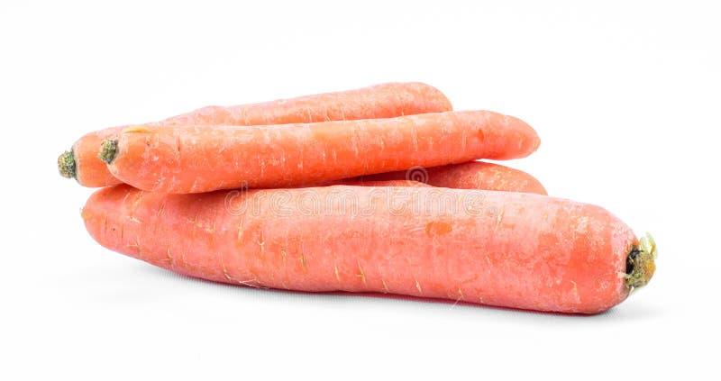 Trois carottes oranges sur un fond blanc photographie stock