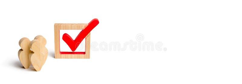 Trois chiffres humains en bois se tiennent ensemble à côté d'un coutil rouge dans la boîte Volontaires, parties, candidats, élect illustration stock