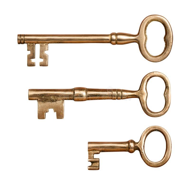 Trois clés en laiton antiques photos stock