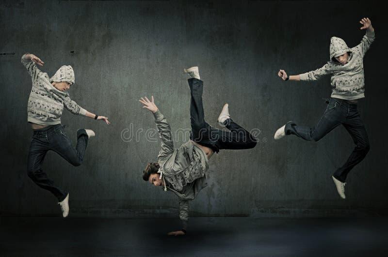 Trois danseurs d'houblon de gratte-cul images stock