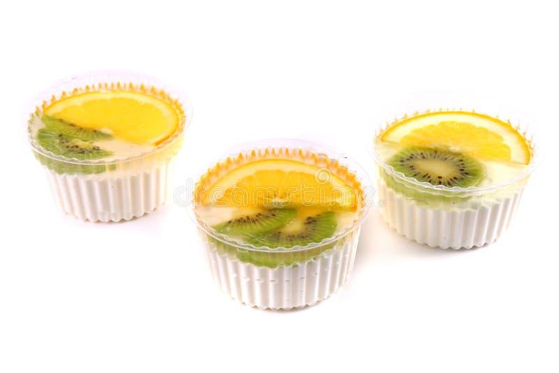 Trois desserts doux avec un kiwi et un citron photos stock