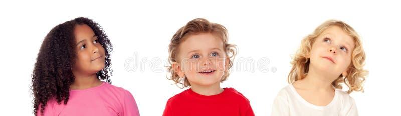 Trois enfants différents images stock