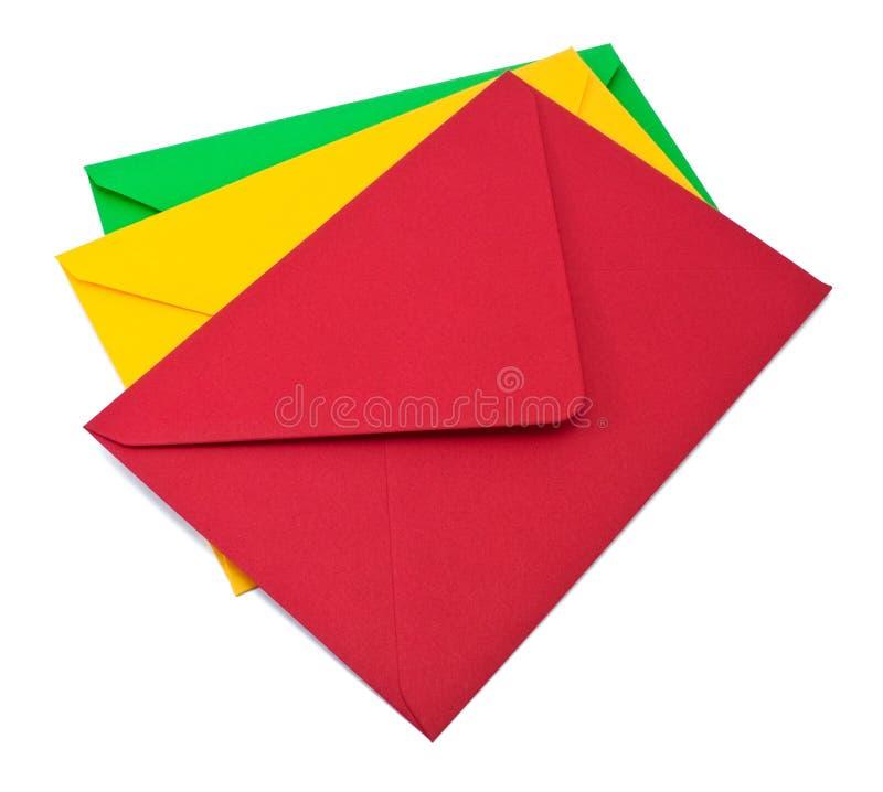 Trois enveloppes sur le blanc image stock