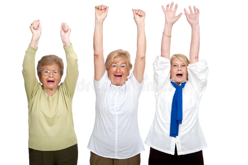 Trois femmes aînés soulevant des mains. photographie stock