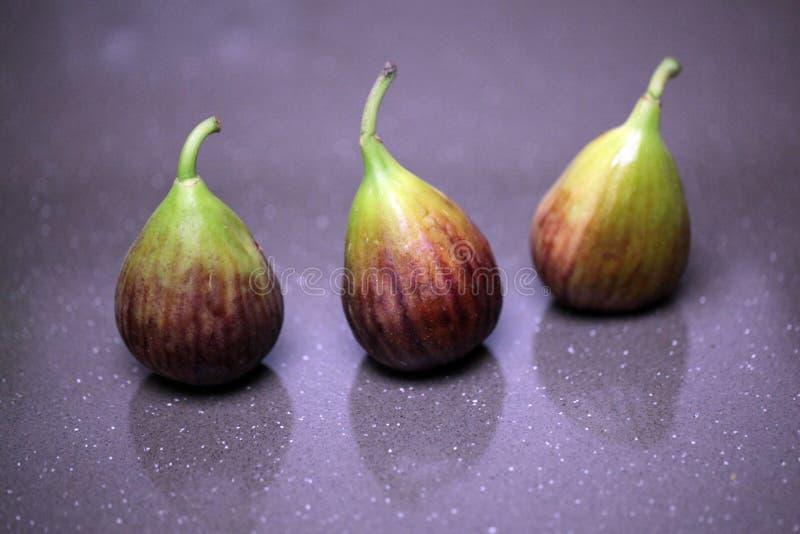 Trois figues fraîches photographie stock
