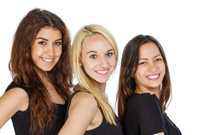 Trois filles dans une rangée image stock