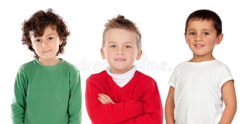 Trois garçons d'associé images stock
