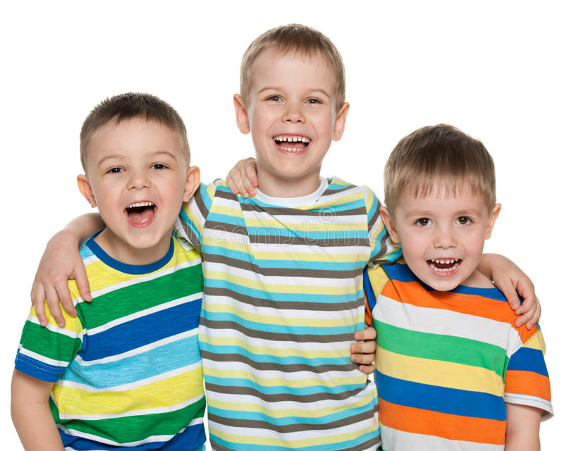 Trois garçons riants photo stock