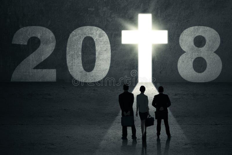Trois gens d'affaires avec le crucifix brillant photo libre de droits