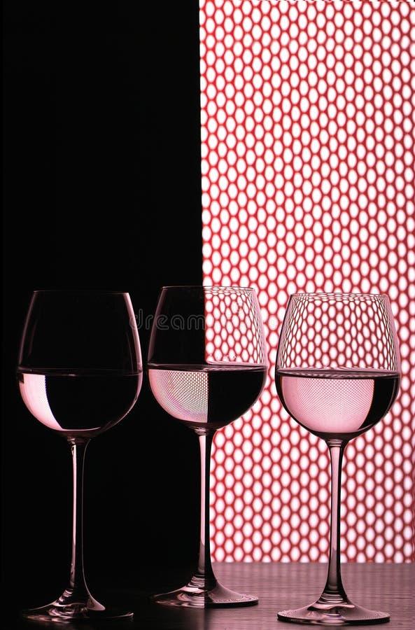 Trois glaces de vin au-dessus de réseau image libre de droits