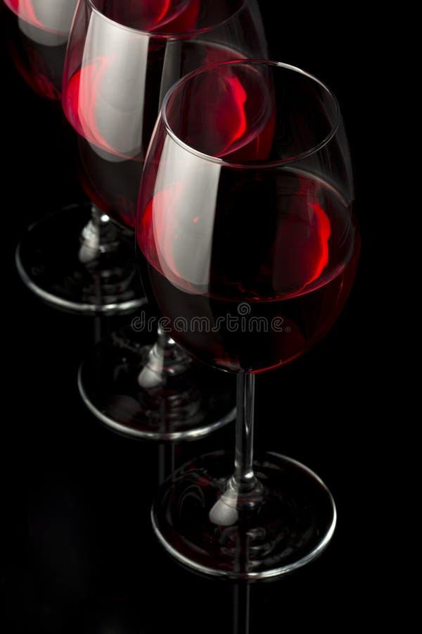 Trois glaces de vin rouge images libres de droits