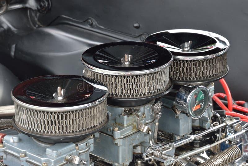 Trois hauts étroits de carburateur images libres de droits