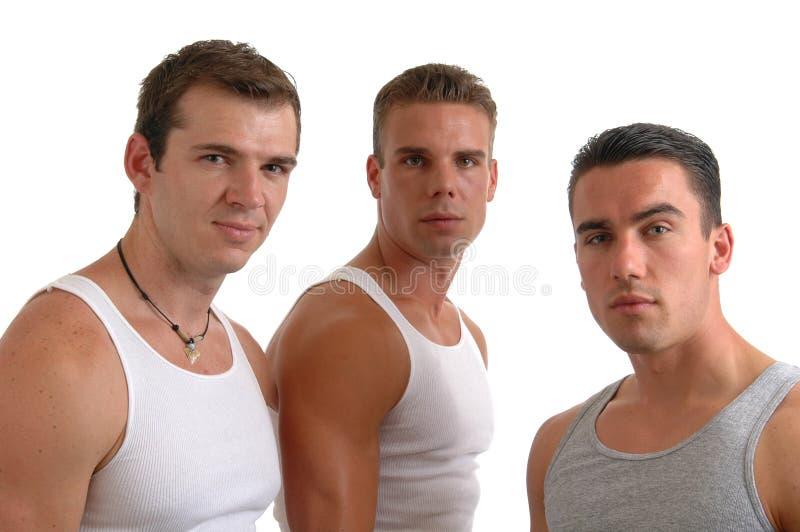 Trois hommes photographie stock