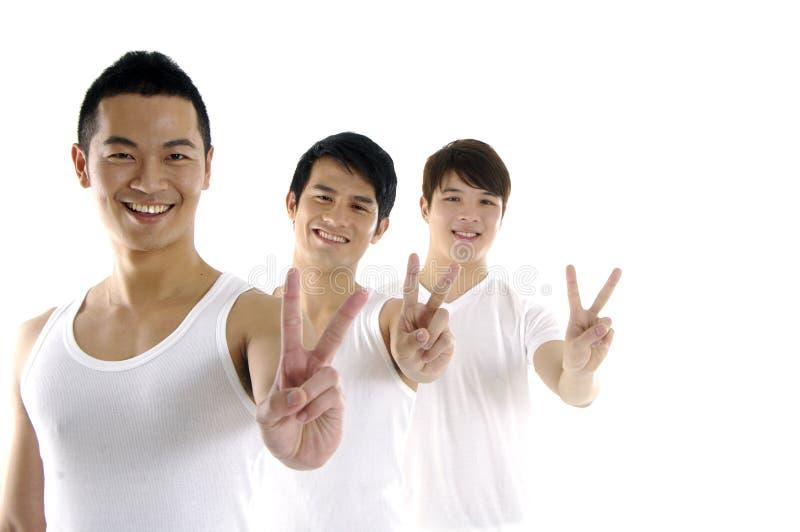 Trois hommes asiatiques occasionnels images libres de droits