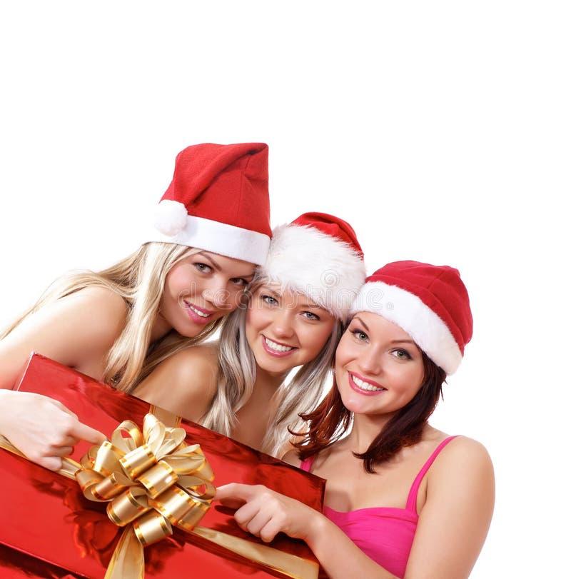 Trois jeunes filles célèbrent Noël photos stock