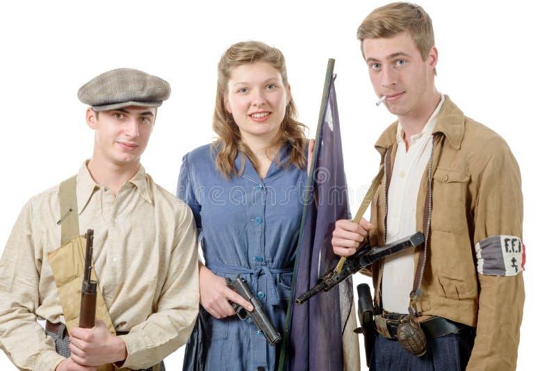 Trois jeunes résistances, vêtements de vintage et armes français, reen photos stock