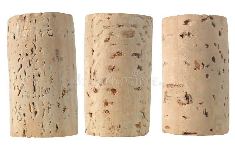 Trois lièges de vin d'isolement photos stock
