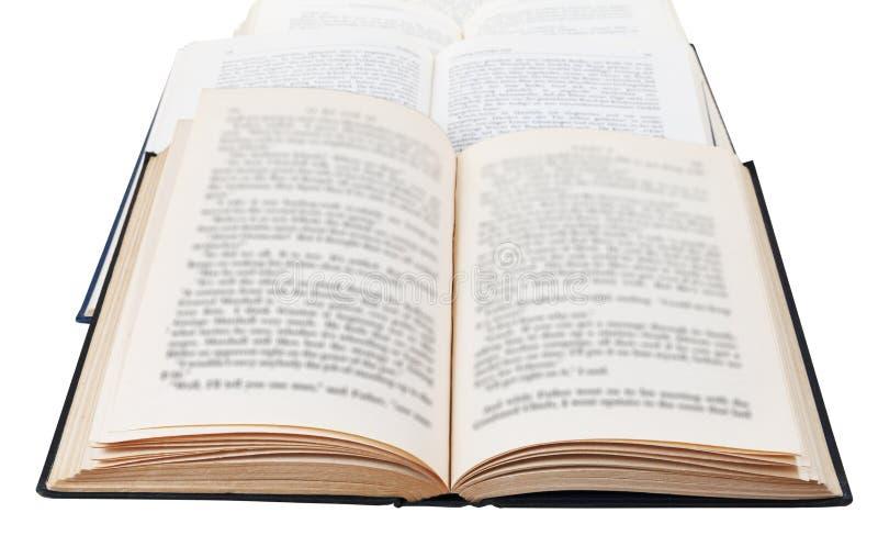 Trois livres ouverts d'isolement sur le blanc photos stock