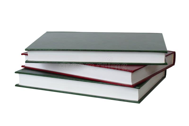 Trois livres sur le blanc image stock