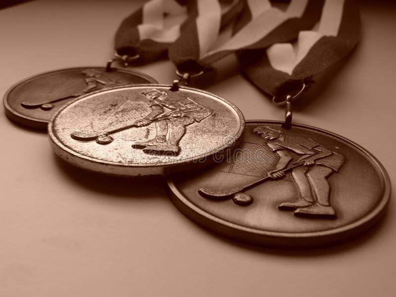 Trois médailles photo stock