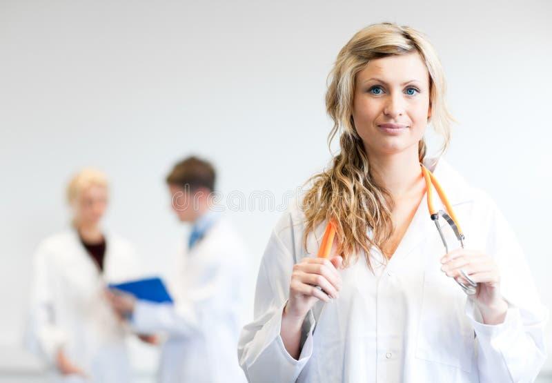 Download Trois médecins photo stock. Image du attrayant, hôpital - 8658466