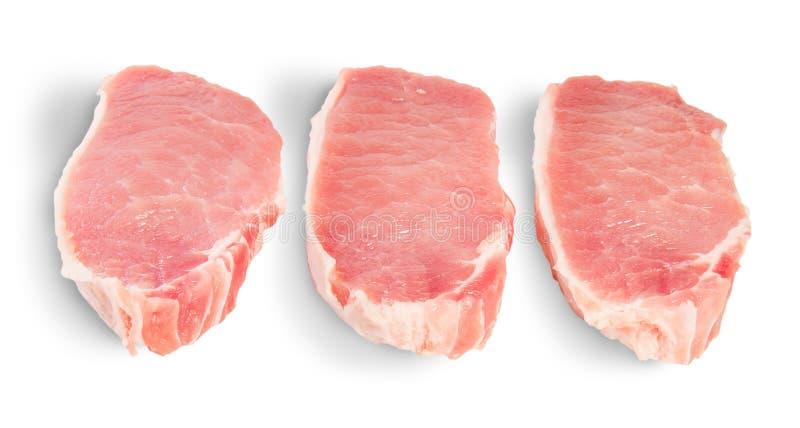 Trois morceaux de porc cru photos libres de droits