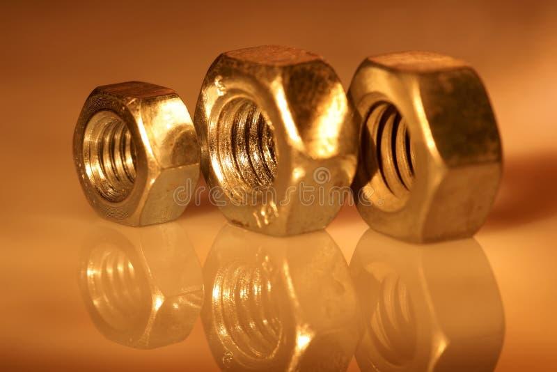 Trois noix d'or. photographie stock libre de droits