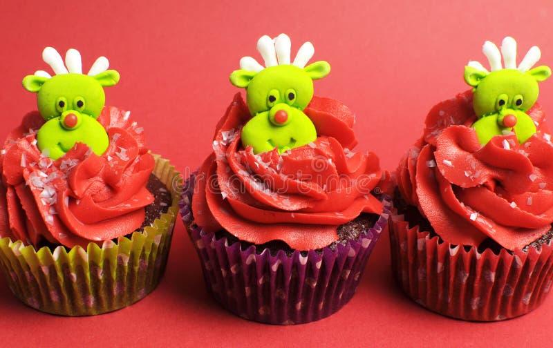 Trois petits gâteaux de Noël avec l'amusement et les visages originaux de renne photos libres de droits
