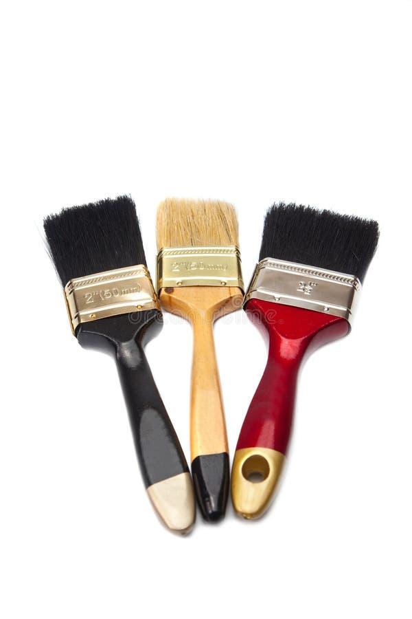Trois pinceaux de différentes couleurs photos libres de droits