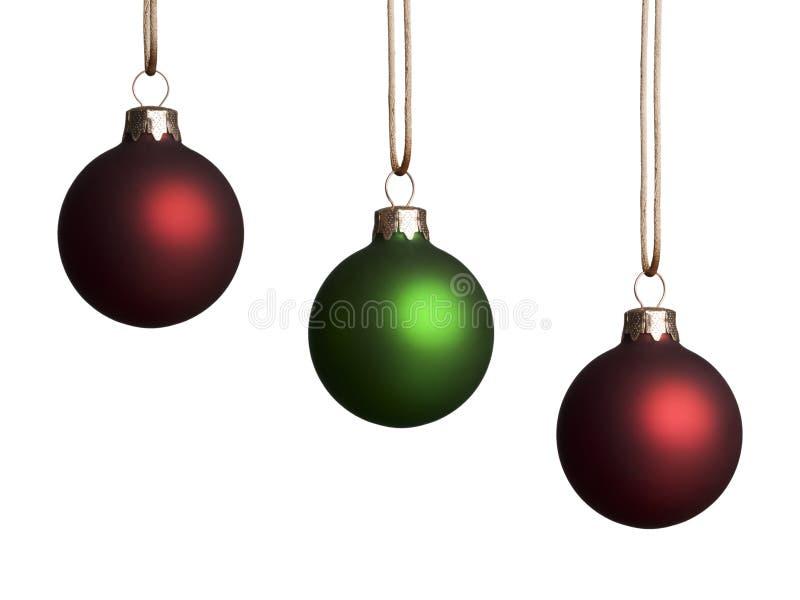 Trois rouges et ornements verts images libres de droits