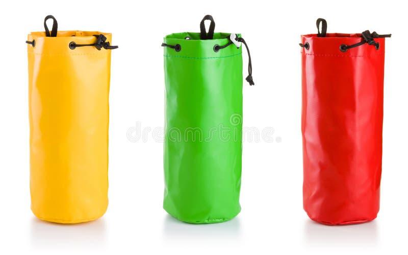 Trois sacs d'équipement sur le fond blanc photos stock