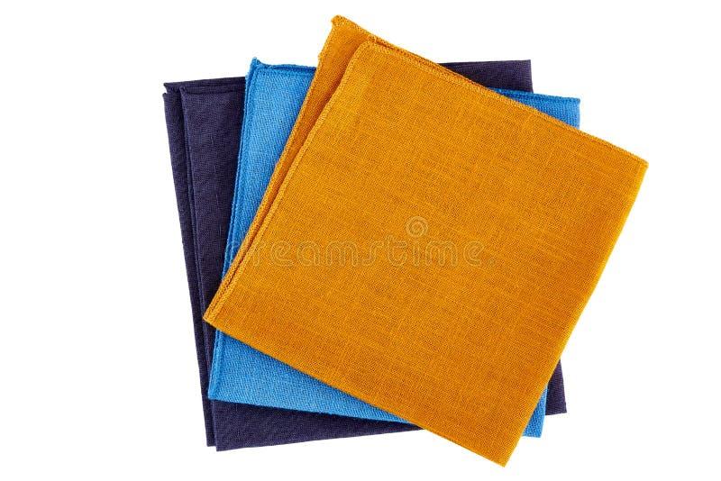 Trois serviettes colorées sur le blanc photos stock