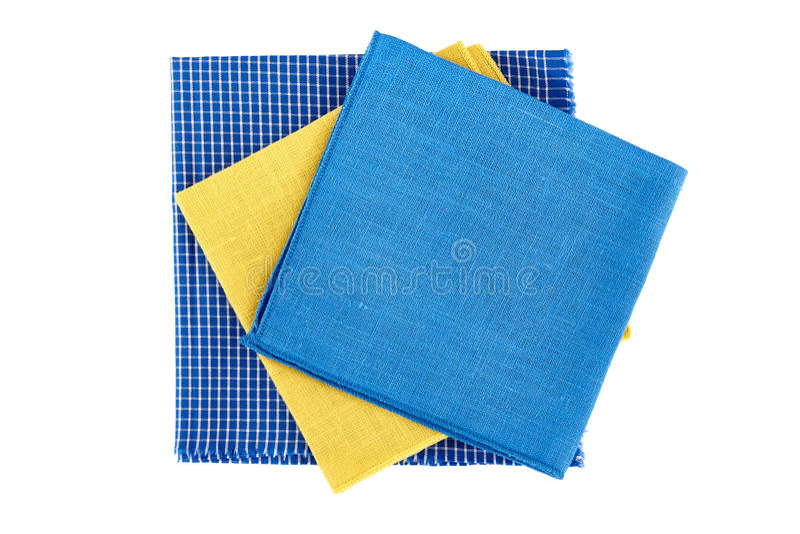 Trois serviettes colorées sur le blanc photographie stock