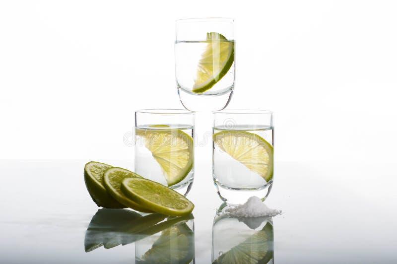 Trois tirs de vodka avec la chaux photos libres de droits