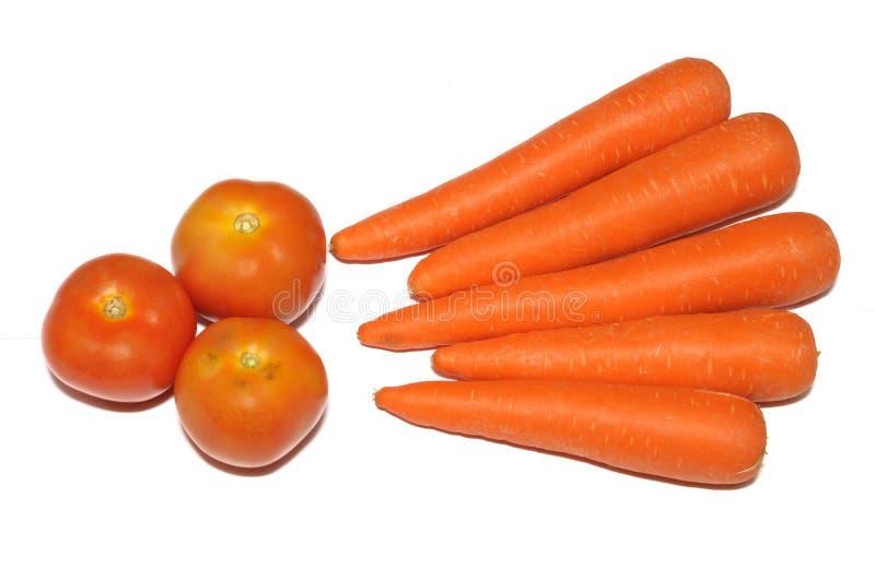 Trois tomates rouges contre un contexte blanc photos stock