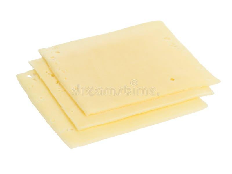 Trois tranches carrées de fromage d'édam photo stock