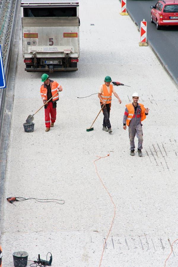 Trois travailleurs de route photo stock