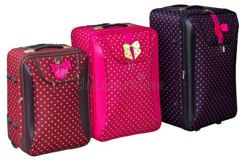 Trois valises colorées photo stock