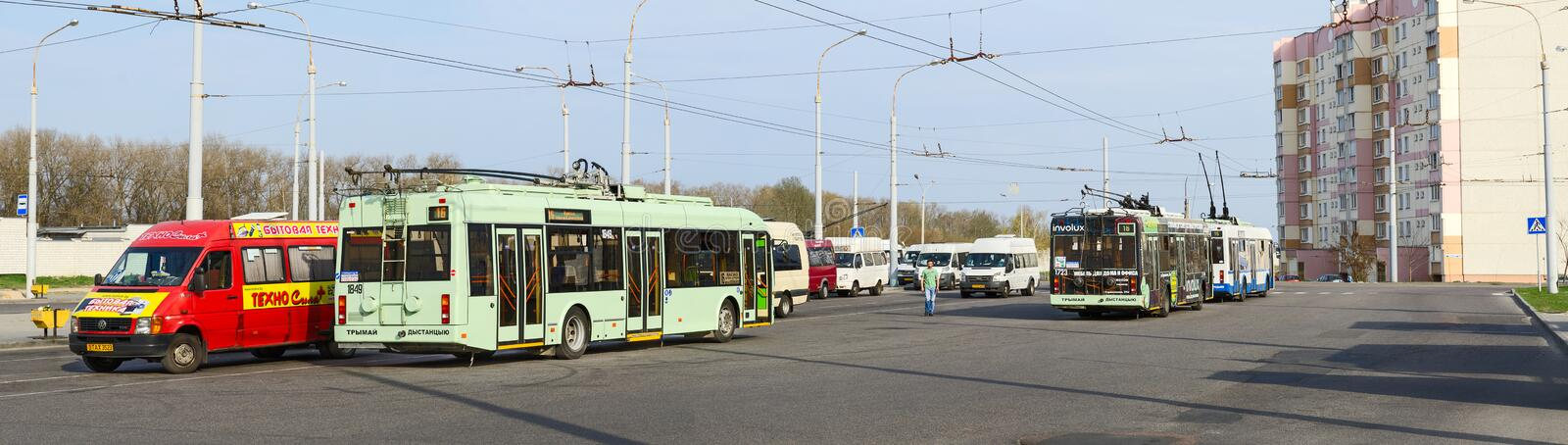 Trolley buses and taxis at final stop, Gomel, Belarus. GOMEL, BELARUS - APRIL 10, 2016: Trolley buses and taxis at the final stop District Klenkovsky, Gomel royalty free stock photo