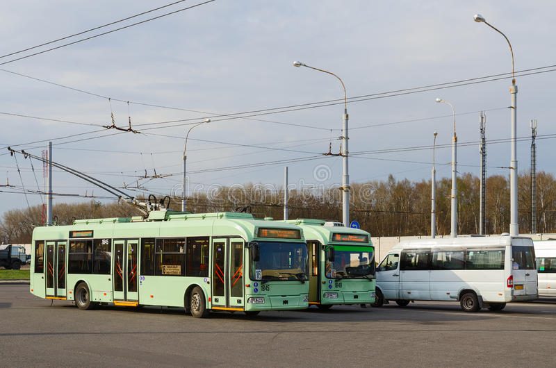 Trolley buses and taxis at final stop, Gomel, Belarus. GOMEL, BELARUS - APRIL 10, 2016: Trolley buses and taxis at the final stop District Klenkovsky, Gomel stock photos