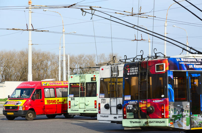 Trolley buses and taxis at final stop, Gomel, Belarus stock images