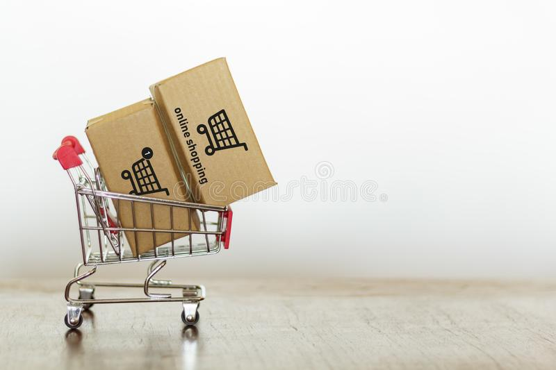 Trolley with cartons against white background with copy space stock image