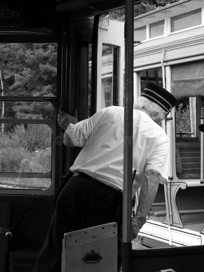 Trolley Conductor leaning out stock images