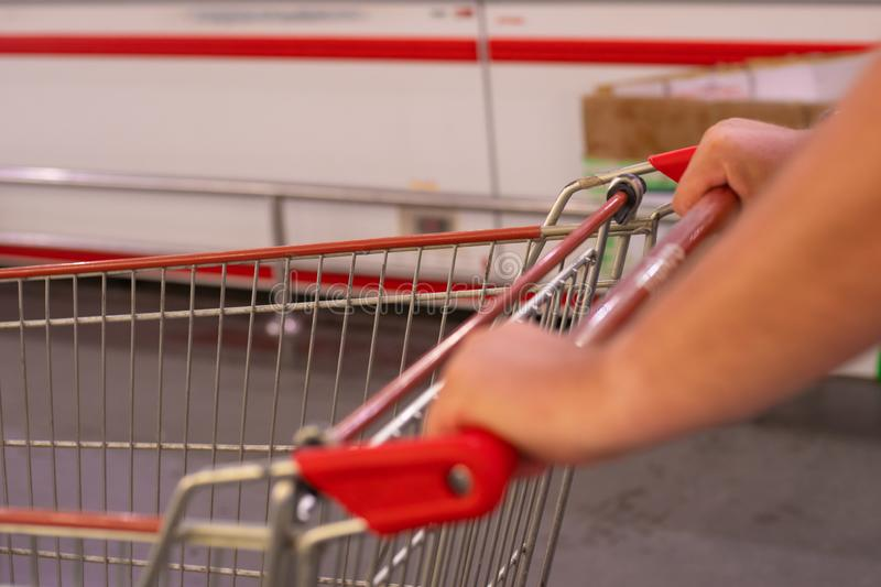 Trolley at the grocery store. Interior of a supermarket, an empty shopping trolley. Business ideas and retail royalty free stock image