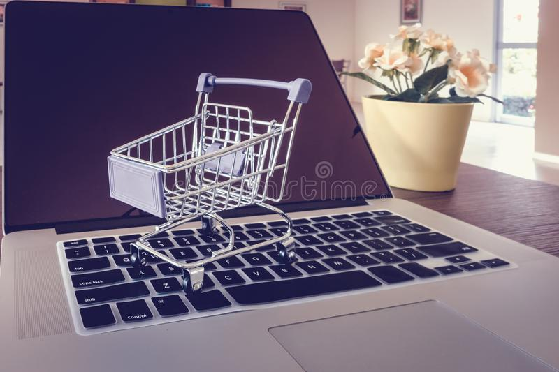 Trolley on a laptop keyboard., Shopping online and business e-commerce concept royalty free stock photo