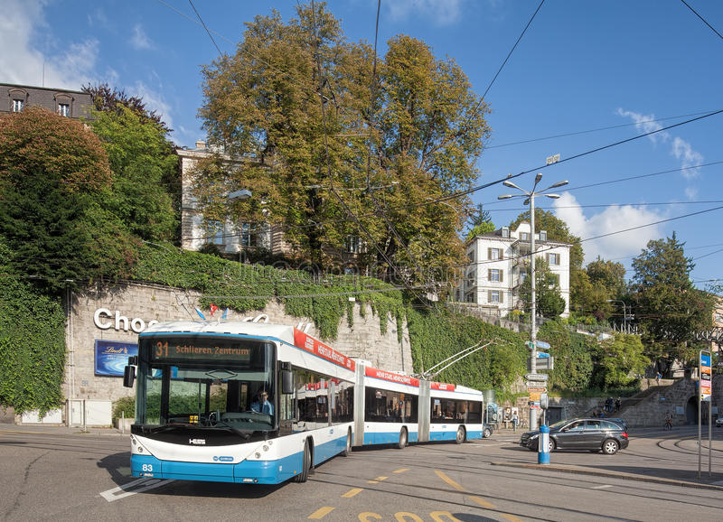 Trolleybus passing the Central square in Zurich. Zurich, Switzerland - 14 September, 2014: a trolleybus passing the Central square. Zurich is the largest city in stock photography