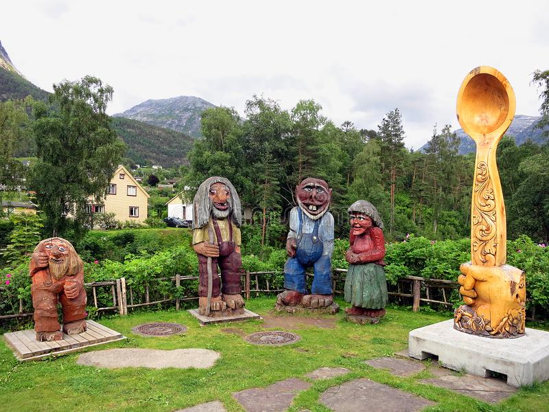 Trolls with a spoon in Kinsarvik. Sculptures of trolls and spoons made of wood near the factory of cutlery, supplying them to the royal court, Kinsarvik, Norway stock photography