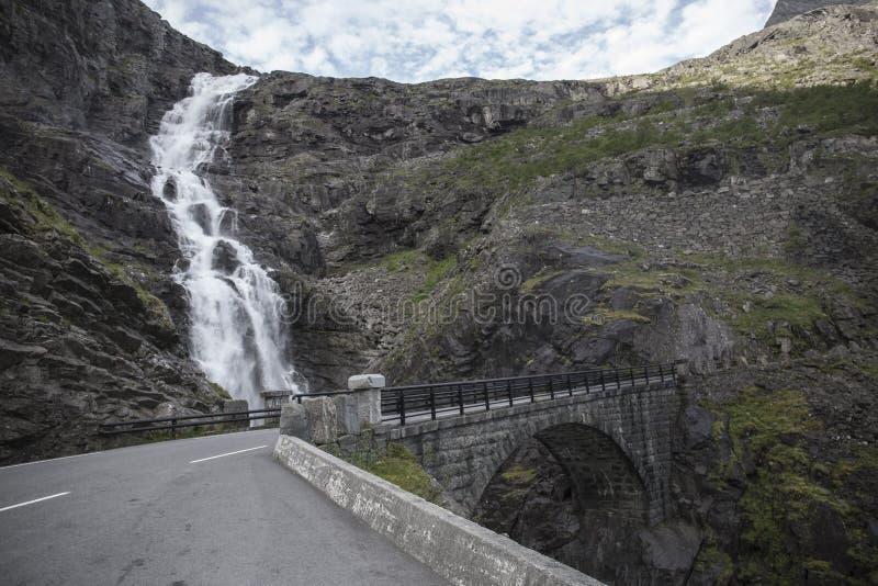 Trollstigen, Bridge - Trolls' Path Mountain Road in Norway. Stone bridge over waterfall Stigfossen on serpentine mountain road, part of road 63 from Ã… stock photography