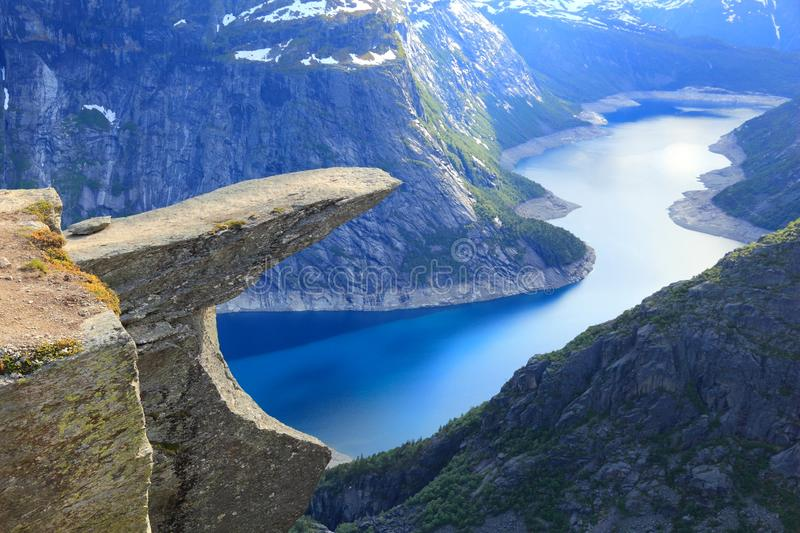 Trolltunga, Norway. Norway tourism attraction - Trolltunga (Troll's Tongue) rock in Hordaland county. Ringedalsvatnet lake stock photo